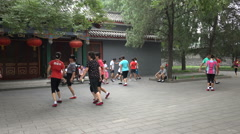 People play a traditional Chinese 'football' game in a park in Beijing Arkistovideo