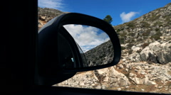 Car mirror driving in the country mountains, super slow motion Stock Footage