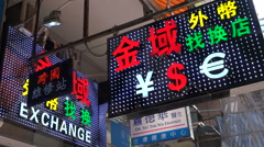 Currency exchange in Hong Kong, dollars, renminbi, dollars, neon lights Stock Footage