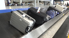 Luggage on the conveyor belt at arrivals hall of Hong Kong International Airport Stock Footage