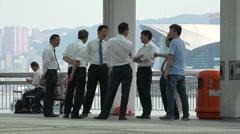 Hong Kong business men, break, office workers, financial, talking, chatting Stock Footage