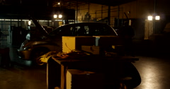 Masked Gunman Approach Inside Warehouse Stock Footage