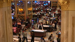 Macau casino, people gambling in Venetian Macao, mainland Chinese visitors Stock Footage