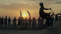 Athletes Making Jumps And Tricks on a Bike on sunset background. Bmx-vert Stock Footage