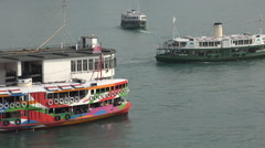 Colorful classic Star Ferries at the Pier in Hong Kong - stock footage
