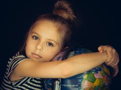 Beautiful girl hugging a globe - stock photo
