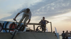 Bmx Stunts at Sunset. Slow Motion of professional Bmx Rider during his - stock footage