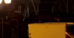 Masked Gunman Approach Inside Warehouse - Profile - stock footage