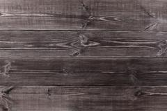 Background of wooden planks black color. - stock photo
