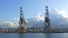 Large industrial cranes in the Port of Palermo, Sicily, Italy. Stock Footage