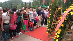 Chinese tour groups bow for Mao Zedong statue in his birthplace Shaoshan Stock Footage