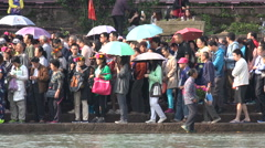 China inequality, local woman sells souvenirs to domestic tourists Stock Footage