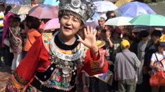 China tourism, woman posing in traditional dress, busy crowded Fenghuang town Stock Footage