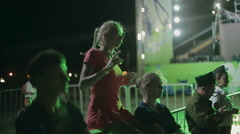 Young Girl Dancing While Sitting on the Parapet at Night Stock Footage