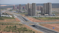 China ghost city, empty highways, apartment buildings, construction sites, Ordos - stock footage