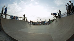 Slow Motion Of Bmx Rider during His Performing tricks in the ramp. Bmx-vert on Stock Footage