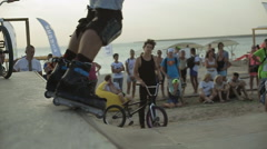 Young Athlete Demonstrates Rollerskating on a ramp during the competition. Slow - stock footage