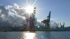 Large industrial cranes with sun in the Port of Palermo, Sicily, Italy. - stock footage