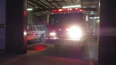 Fireman Getting In Fire Truck at Fire Station Stock Footage