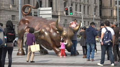 Chinese tourists visit Bund financial Bull statue in Shanghai, China Stock Footage