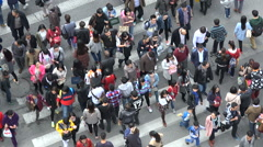 Time lapse of people crossing a busy zebra in Shanghai, China - stock footage