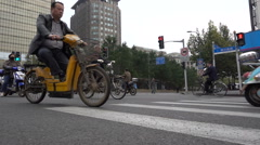Slow motion low angle video of commuting motorcyclists in Shanghai, China Stock Footage