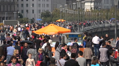 Tourist crowds visit the popular Bund in Shanghai, China Stock Footage