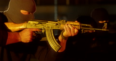 Masked Gunman Open Fire Inside Warehouse - Profile Close Up - stock footage