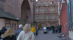 People walking by the Church of the Holy Spirit in Marktplatz, Heidelberg Stock Footage
