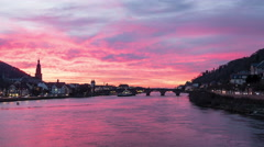 Night falling over Neckar river and Heidelberg city, time lapse Stock Footage