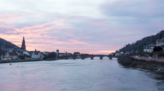 Beautiful sunset over Neckar River in Heidelberg, time lapse Stock Footage