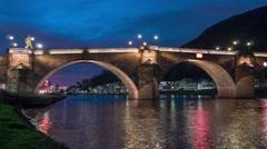 Karl Theodor Bridge over Neckar River at night in Heidelberg, time lapse Stock Footage