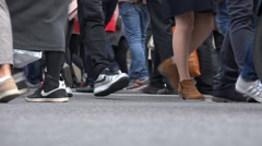 China Shanghai busy zebra crossing feet legs shoes jeans low angle Stock Footage