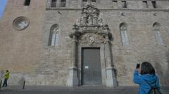 Taking pictures and walking near Iglesia de los Santos Juanes in Valencia Stock Footage