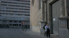 Tourists walking by The Santos Juanes church in Valencia Stock Footage