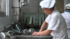Worker cleaning washing dishes in a scullery at the Shanghai University in China Stock Footage