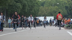 China higher education, students cycle across campus Shanghai University Stock Footage