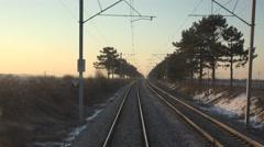 Stock Video Footage of 4K POV Point of view train pass landscape green tree winter season sunrise trip