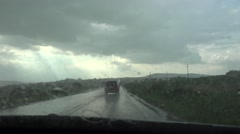 4K POV Point of view car transportation rural street heavy rain drop fall storm Stock Footage