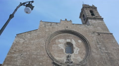 Low angle view of The Santos Juanes church's belfry on a sunny day in Valencia Stock Footage