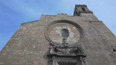 View of The Santos Juanes church with sculptures and belfry in Valencia Stock Footage