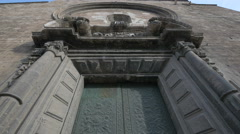 Low angle view of Santos Juanes church's door in Valencia Stock Footage