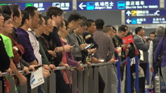 Pickup service, people meet airline passengers, arrivals hall, Shanghai, China Stock Footage