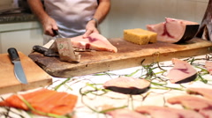 Closeup shot of fishmonger slicing a swordfish in a fish market in Sardinia. Stock Footage
