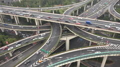 Busy interchange, rush hour traffic, highway, infrastructure in Shanghai, China Stock Footage