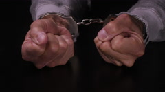 MALE HANDS IN HANDCUFFS - stock footage