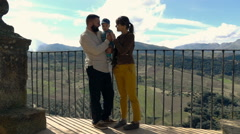 Young, happy family standing on the view point terrace, super slow motion - stock footage