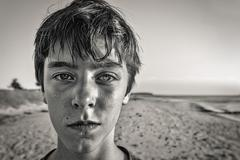 Bw portrait of a teenage boy at the beach Stock Photos