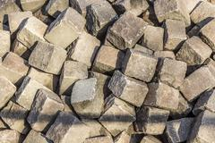 pile with old cobble stones - stock photo