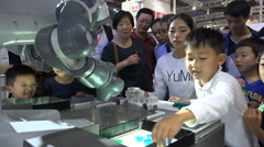 China robotics, technology, curious children play a game against a machine Stock Footage